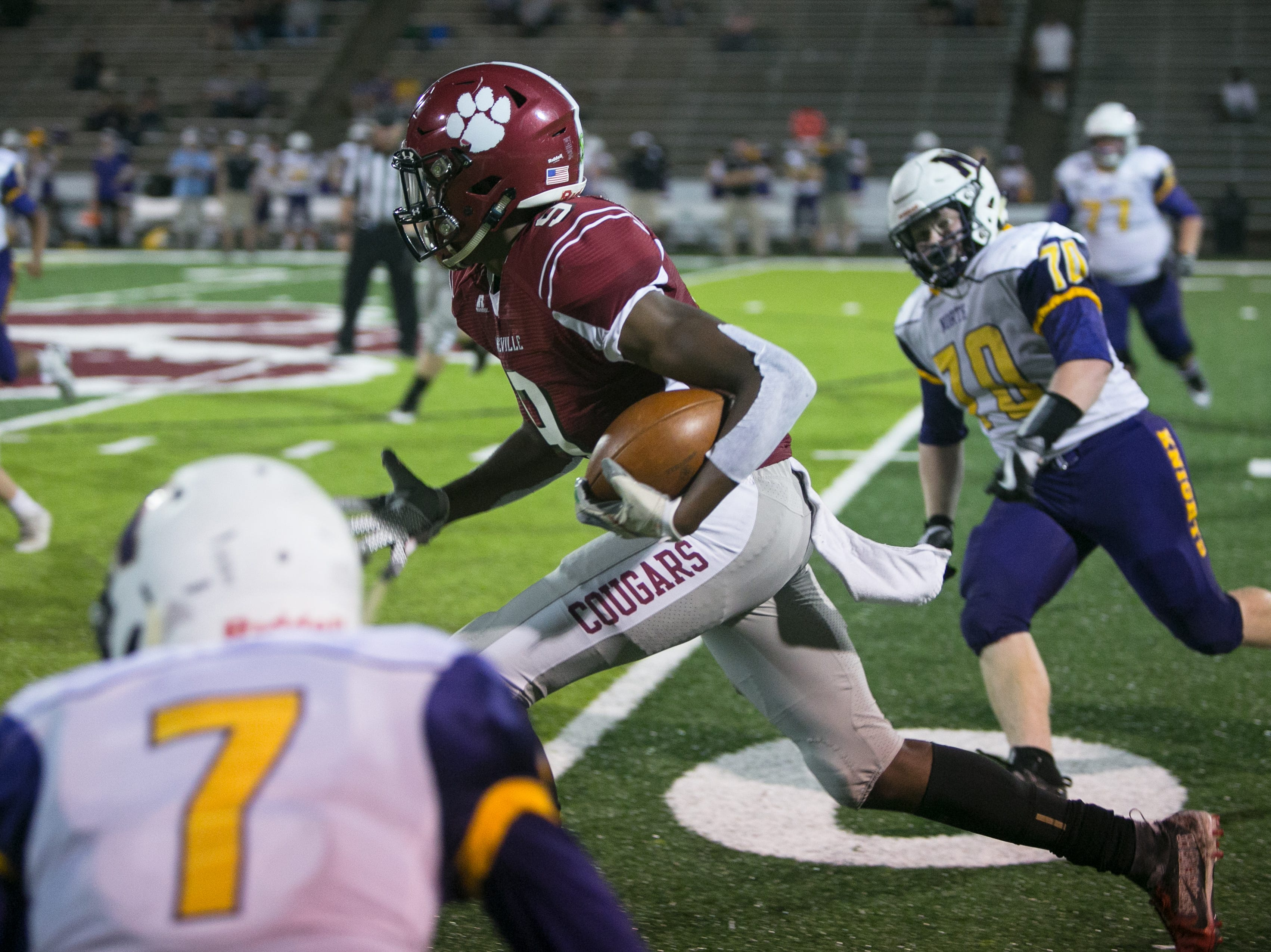 Asheville's Famous Pasley runs the ball on Friday, September 28th, 2018 as Asheville High beat out North Henderson at Asheville, with a final score of 50-14.  Pasley became the school's all-time touchdown reception leader during Friday's game.