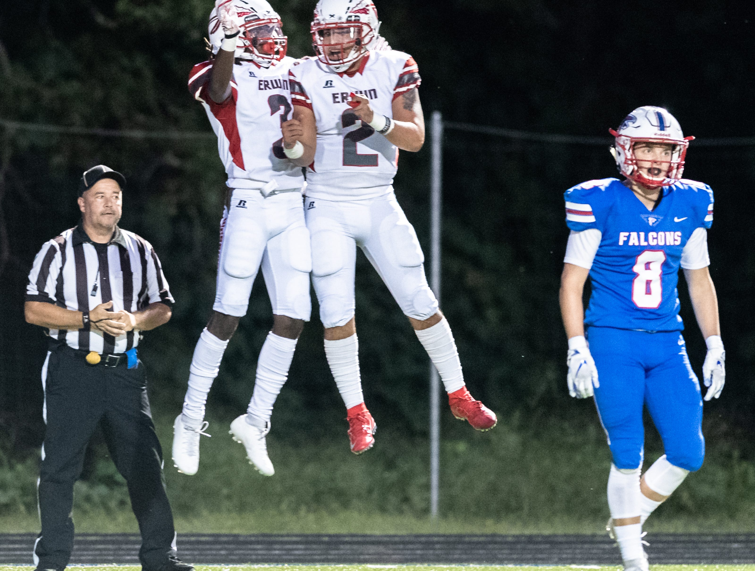 Erwin's Simeon Thompson and Kendrick Weaver celebrate Thompson's touchdown during their game at West Henderson Sept. 28, 2018.