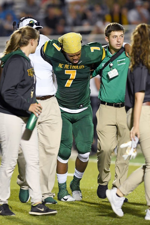 Reynolds' I'dre Bell is carried off the field with an injury during their game at Reynolds High School on Sept. 28, 2018. The Rockets defeated the Mountaineers 37-0.