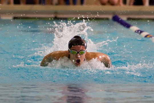 Harper Creek's Alysa Wager helps the Beavers win the 200 freestyle relay at the All-City Meet.