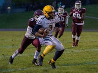 BCC's Tyshaan Williams runs away from a defender during this loss to Kalamazoo Central.