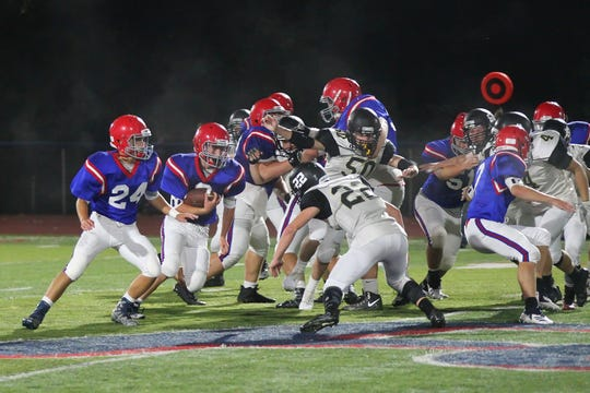 Windsor's Noah Yadlosky (22) attempts to make a tackle against Chenango Forks in Week 5.