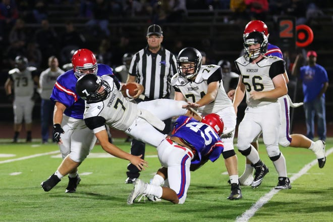 Jeremiah Allen makes the tackle for Forks on  Zach Wolcott from Windsor.