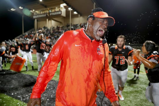 Central Kitsap head football coach Mark Keel gets doused with the water buckets after he recorded his 100th career victory with a win over Shelton at Silverdale Stadium on Friday, September 28, 2018.