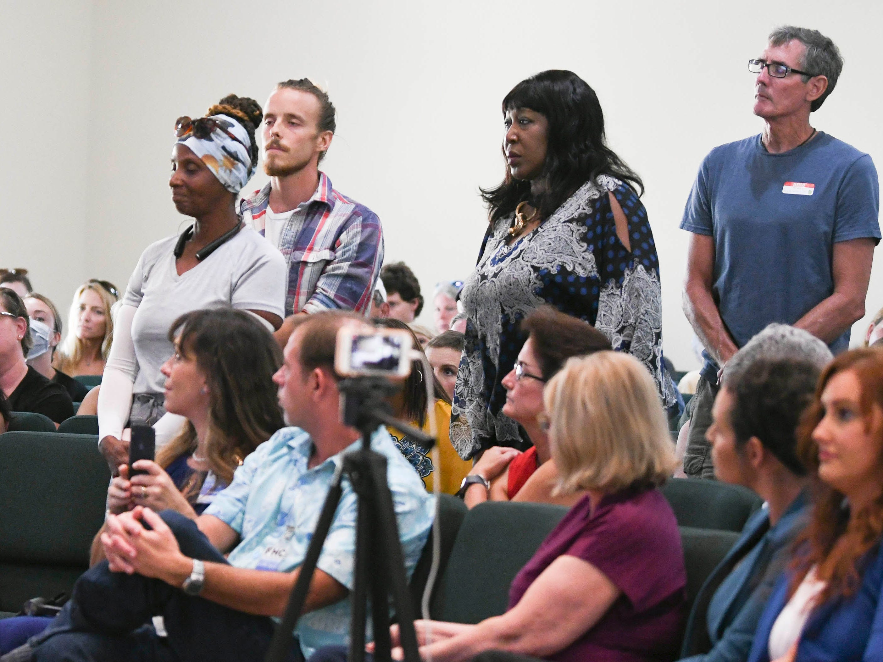 Residents stand in line to ask questions of environmental activist Erin Brockovich and her associate Bob Bowcock during a town hall at Kingdom Gate Worship Center.