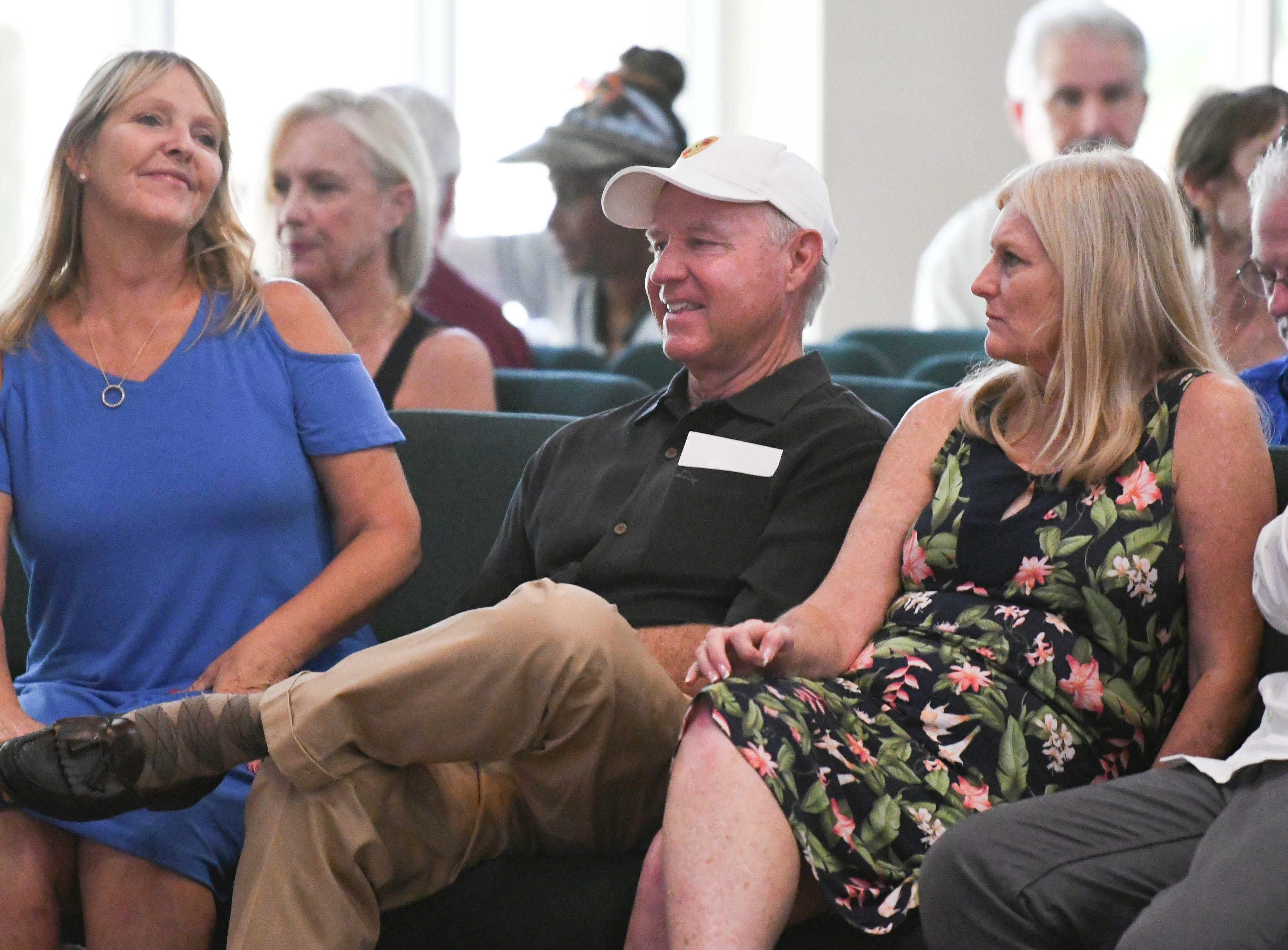 Residents listen to environmental activist Erin Brockovich and her associate Bob Bowcock as they talk during a town hall at Kingdom Gate Worship Center.
