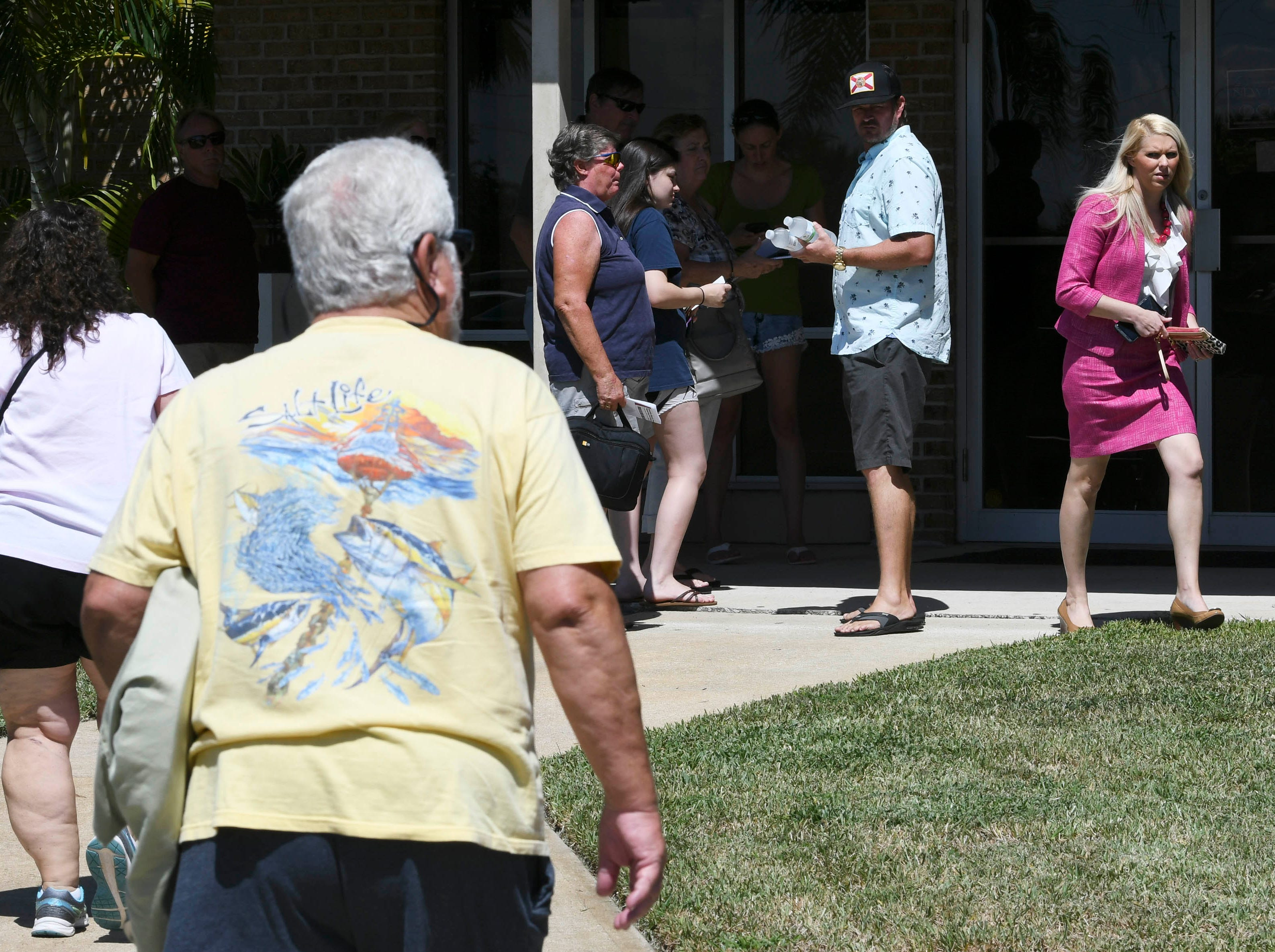 Residents enter the Kingdom Gate Worship Center in Satellite Beach to hear environmental activist Erin Brockovich and her associate Bob Bowcock.