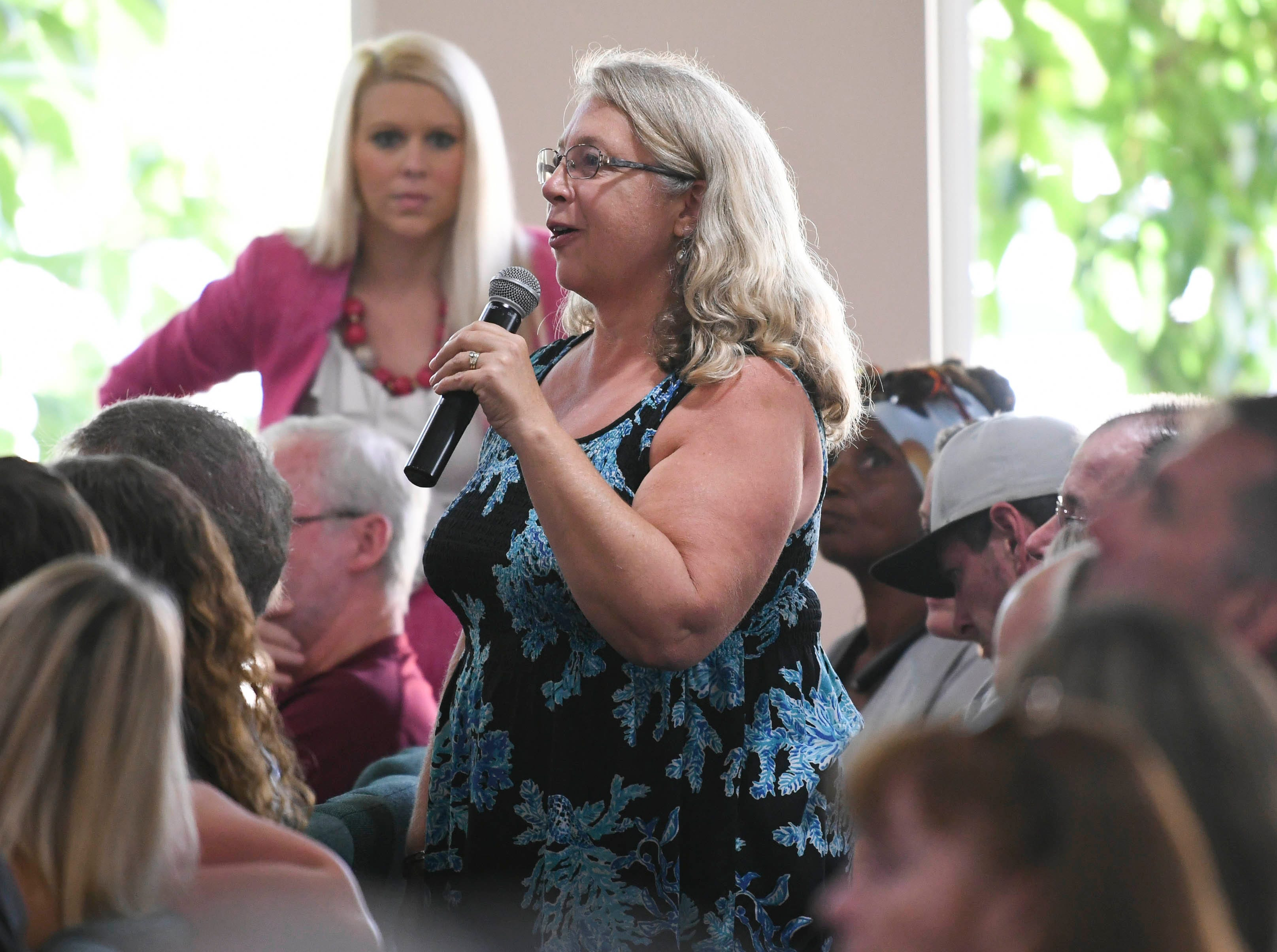 Residents asks questions of environmental activist Erin Brockovich and her associate Bob Bowcock during a town hall at Kingdom Gate Worship Center.