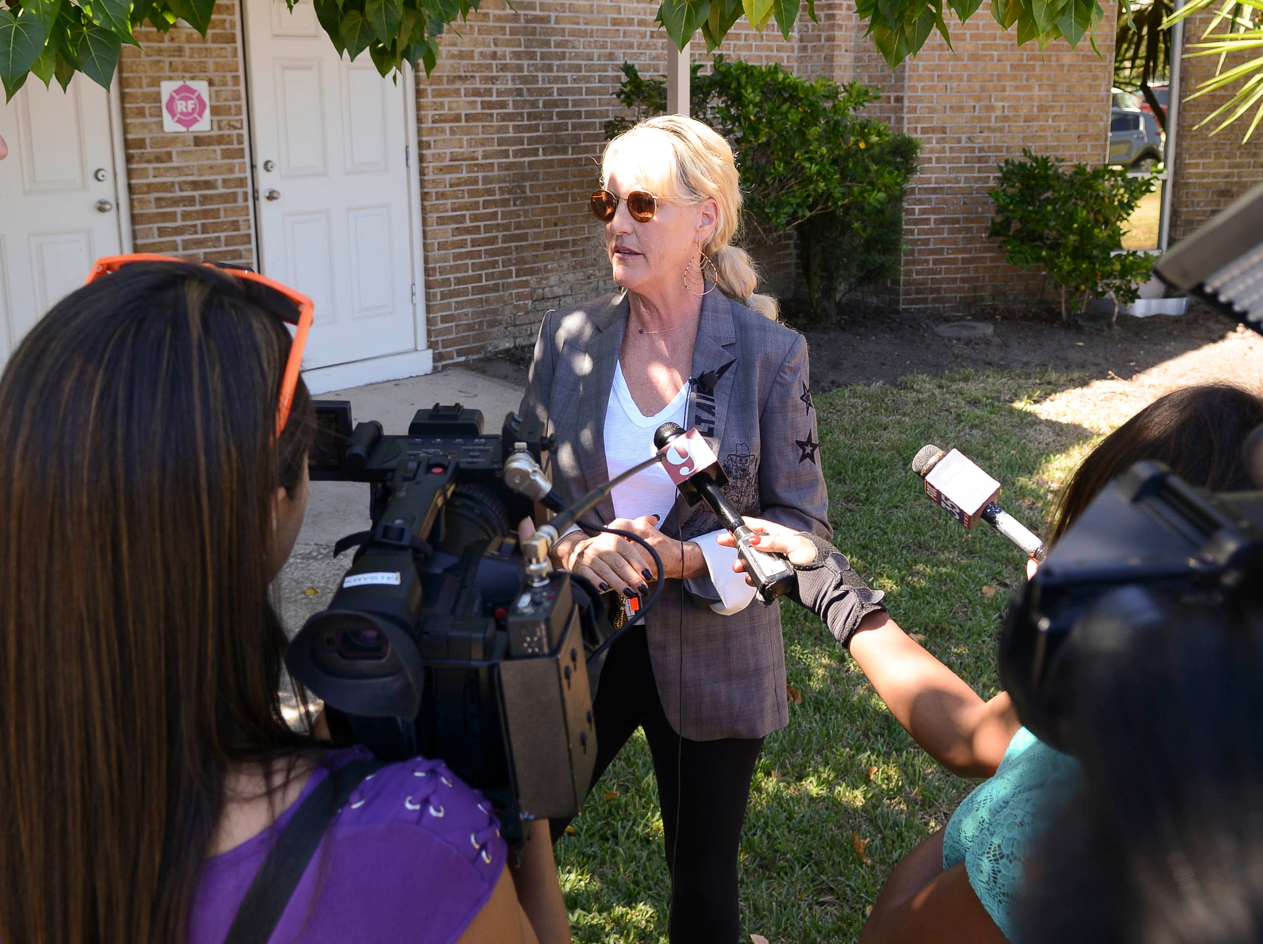Environmental activist Erin Brockovich talks to the news media before a town hall at Kingdom Gate Worship Center in Satellite Beach.