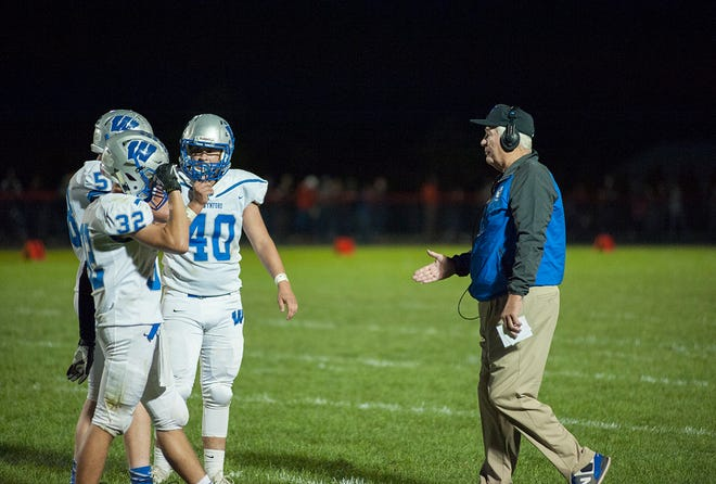 A Wynford coach talks to his players during a break.