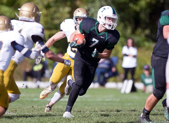 Rice's John Rousseau (7) takes a handoff against Essex during Saturday's high school football game in South Burlington.
