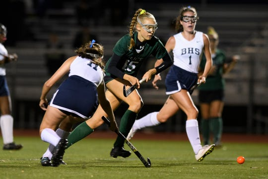 Rice's Hadley Murphy (15) plays the ball during the field hockey game between the Rice Green Knights and the Burlington Sea Horses at Buck Hard Field on Friday night September 28, 2018 in Burlington.