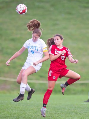 Champlain Valley's Sara Kelley, right, wins a header past South Burlington's Madison Druzba during Saturday's girls soccer game in Hinesburg.