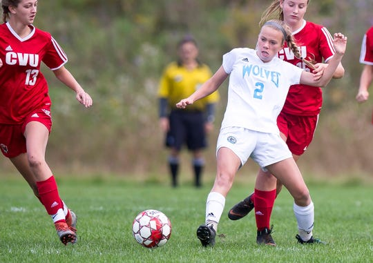 South Burlington's Ava Hamme (2) passes away from pressure against Champlain Valley during Saturday's girls soccer game in Hinesburg.