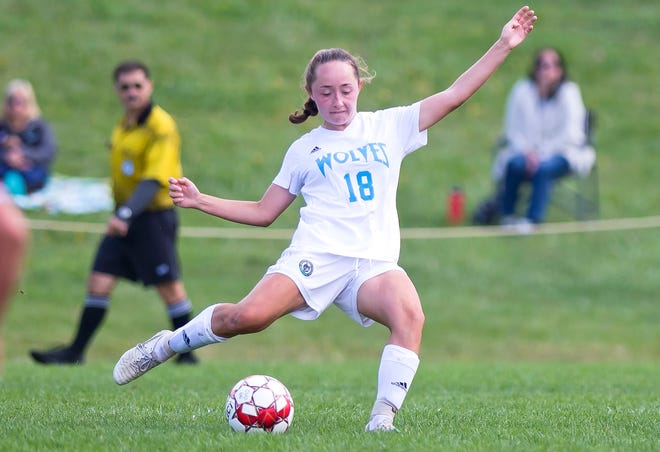 South Burlington's Grace Johnson fires the ball up field against Champlain Valley during Saturday's girls soccer game in Hinesburg.