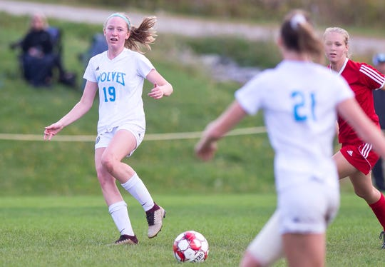 South Burlington's Madison King-Thurber, left, slips a pass to a teammate during Saturday's girls soccer game in Hinesburg.