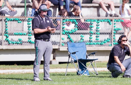 Rice coach Neil Brodeur, left, watches the action against Essex during the 2018 high school football season.