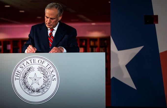 Texas Governor Greg Abbott writes notes before a gubernatorial debate against Democratic challenger Lupe Valdez  at the LBJ Library in Austin, Texas, on Friday, Sept. 28, 2018.  (Nick Wagner/Austin American-Statesman via AP, Pool)