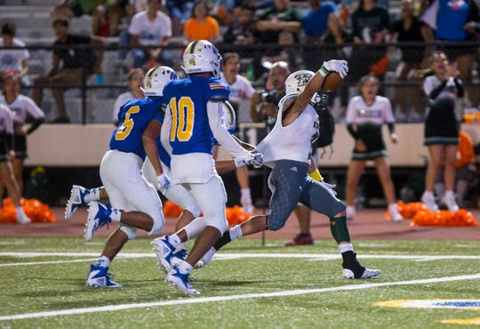 King Mustangs' Nathaniel Guy scores a touchdown during the game against the Moody Trojans at Buc Stadium on Friday, September 28, 2018.