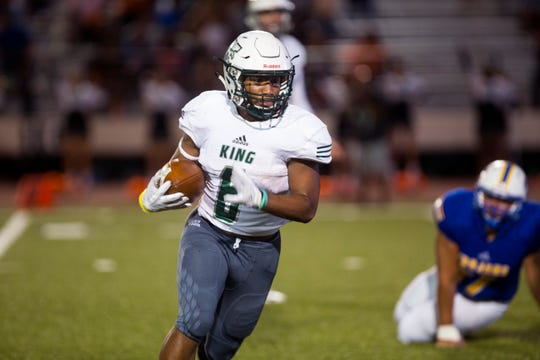 King Mustangs' Bryson Butler carries the ball in the first quarter of the game against the Moody Trojans at Buc Stadium on Friday, September 28, 2018.