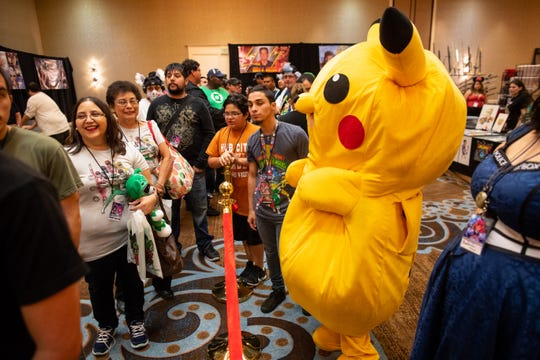 A person dressed as Pikachu waits inline during Realms Con 2018 the Omni Corpus Christi on Saturday, Sept. 29, 2018.