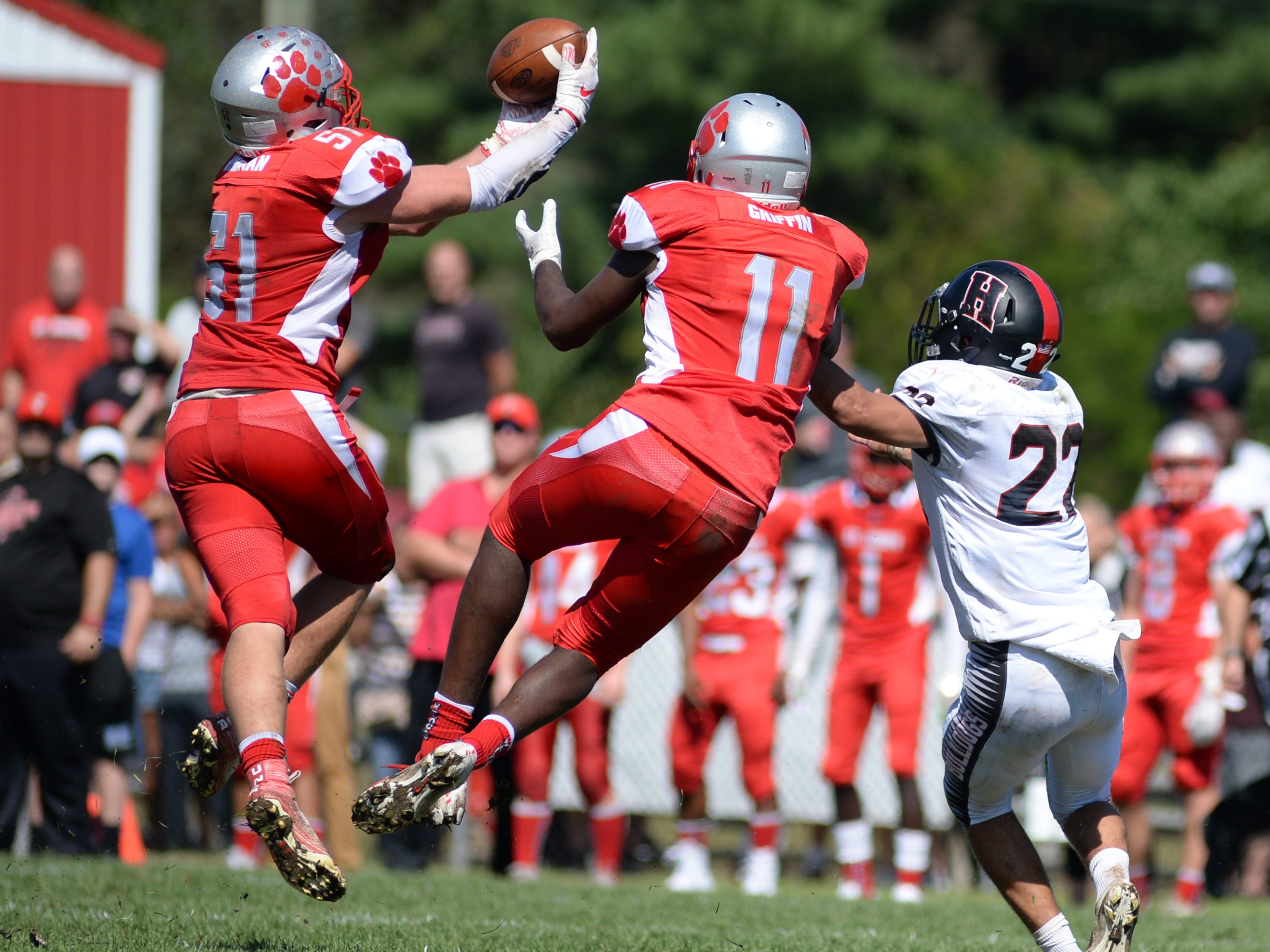 St. Joseph's Bobby Hyndman intercepts a Haddonfield pass intended for Chris Brown during Saturday's game, Sept. 29, 2018.