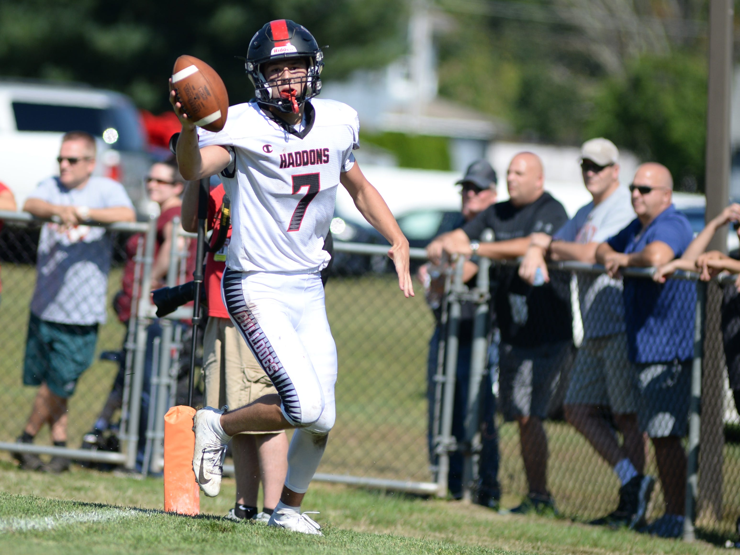 Haddonfield's Drew Gavranich celebrates as he runs the ball for a touchdown during Saturday's game against St. Joseph, Sept. 29, 2018.