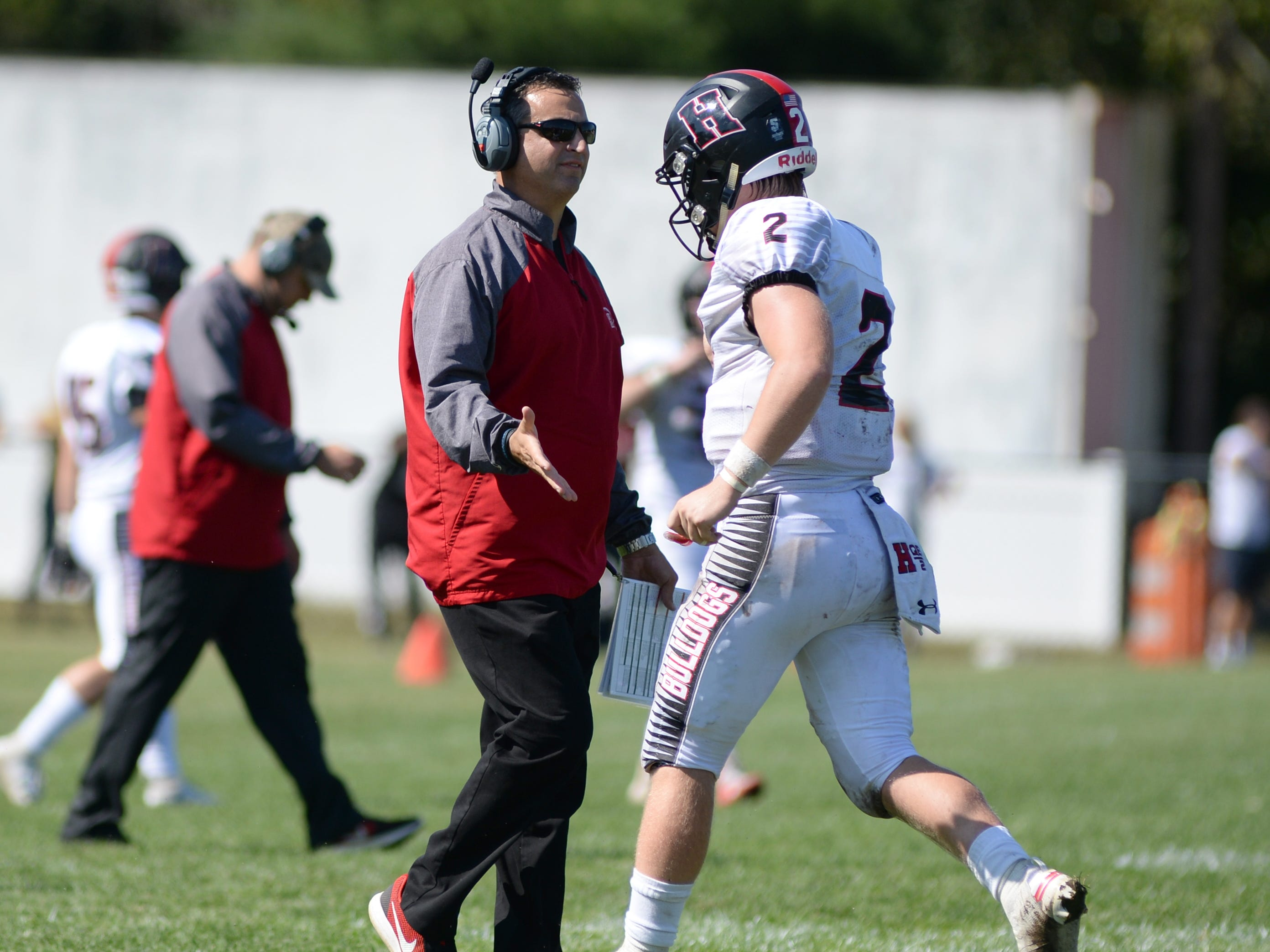 Haddonfield quarter back Jay Foley high fives coach Frank DeLano after throwing a touchdown pass during Saturday's game against St. Joseph, Sept. 29, 2018.