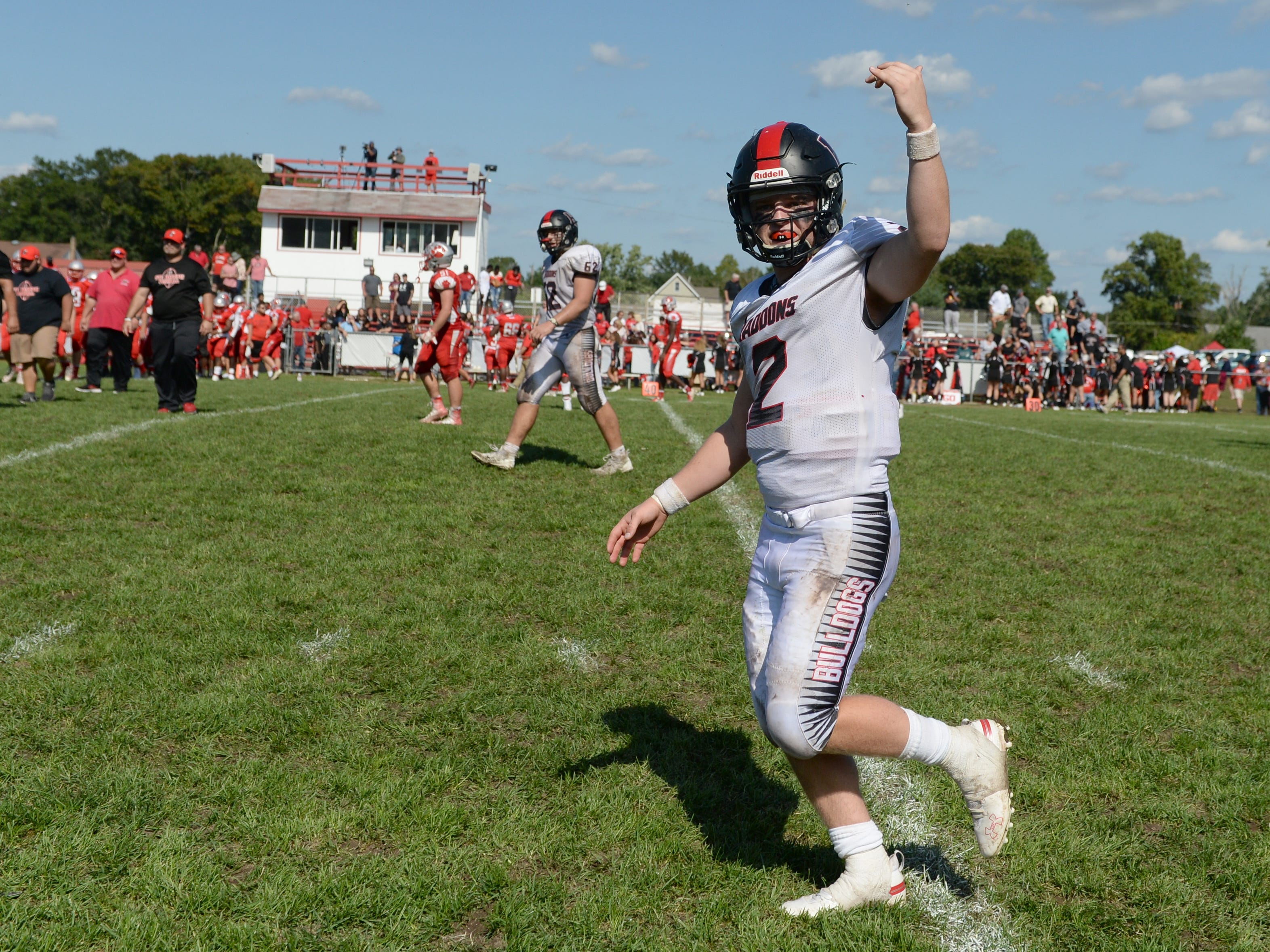 Haddonfield quarter back Jay Foley signals his teammates onto the field after defeating St. Joseph on Saturday, Sept. 29, 2018.