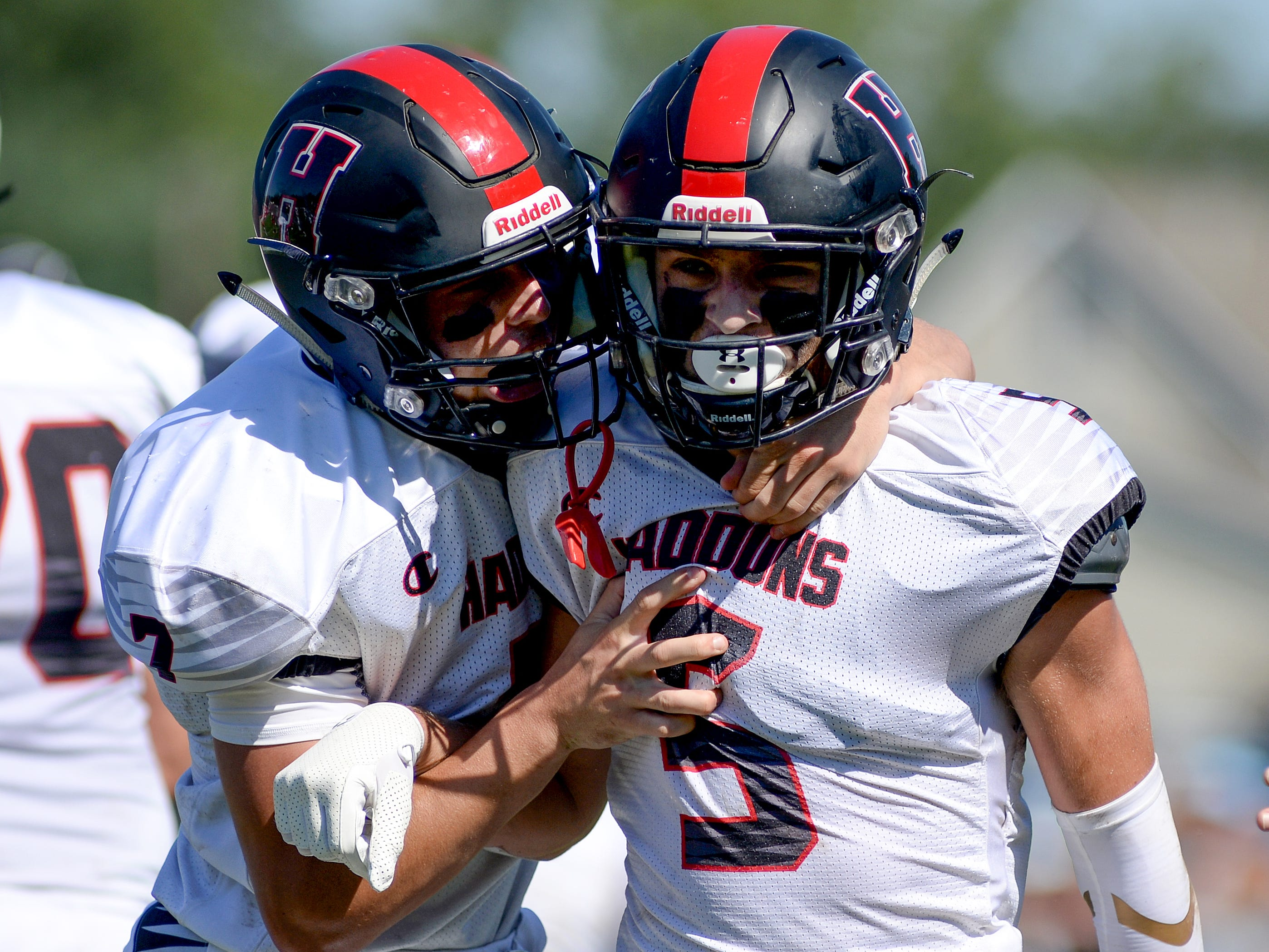 Haddonfield's Johnny Foley (5) gets a hug from Drew Gavranich after scoring a touchdown during the first half of Saturday's game against St. Joseph, Sept. 29, 2018.