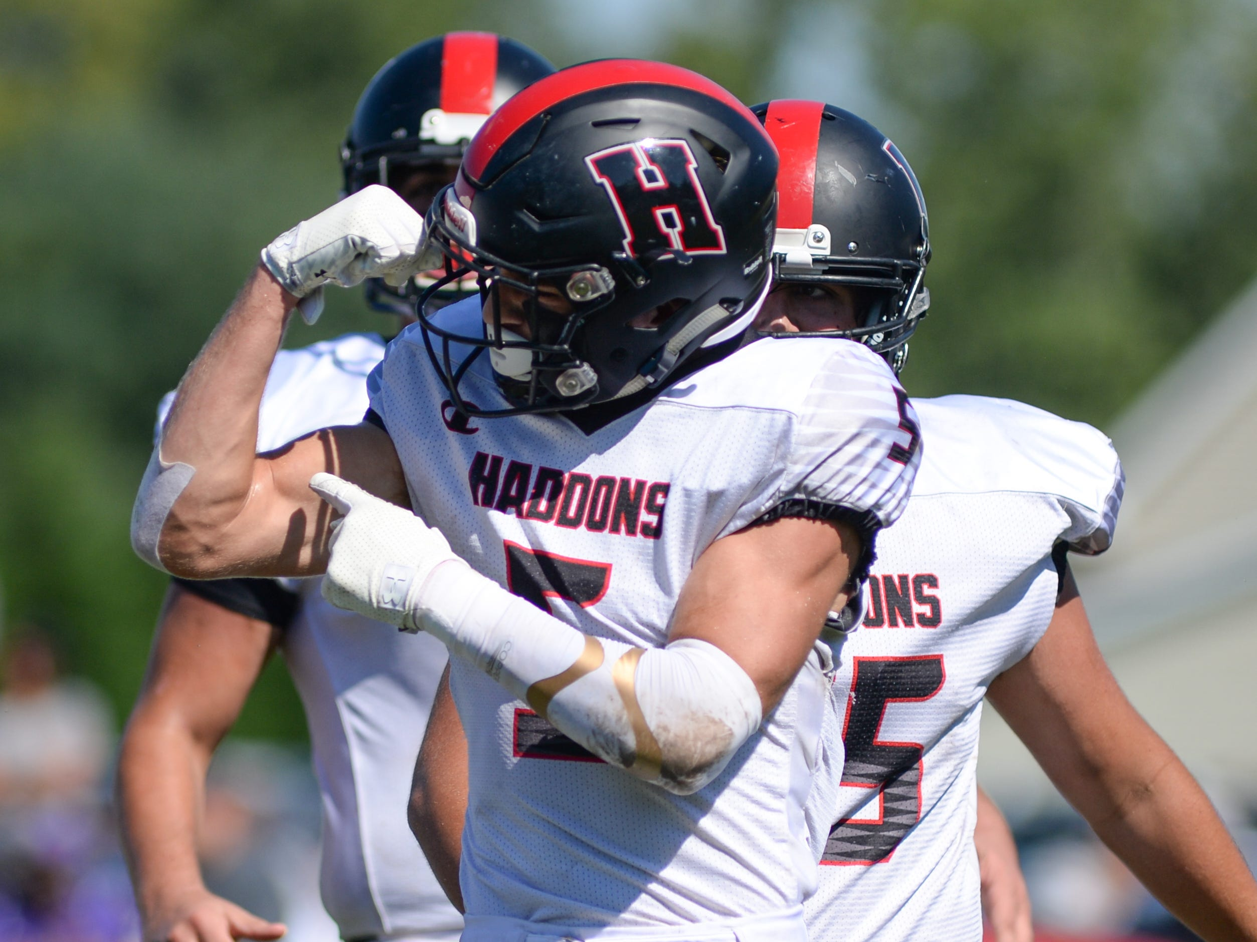 Haddonfield's Johnny Foley (5) celebrates after scoring a touchdown during the first half of Saturday's game against St. Joseph, Sept. 29, 2018.