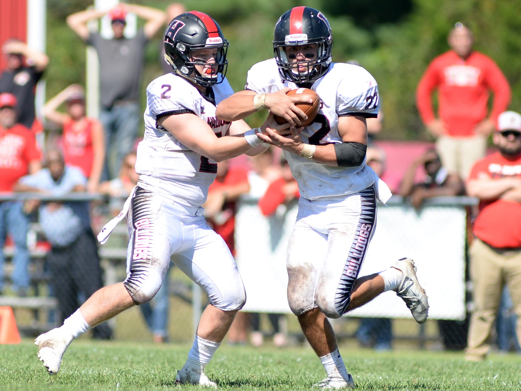 Haddonfield quarter back Jay Foley hands off to Chris Brown during Saturday's game against St. Joseph, Sept. 29, 2018.