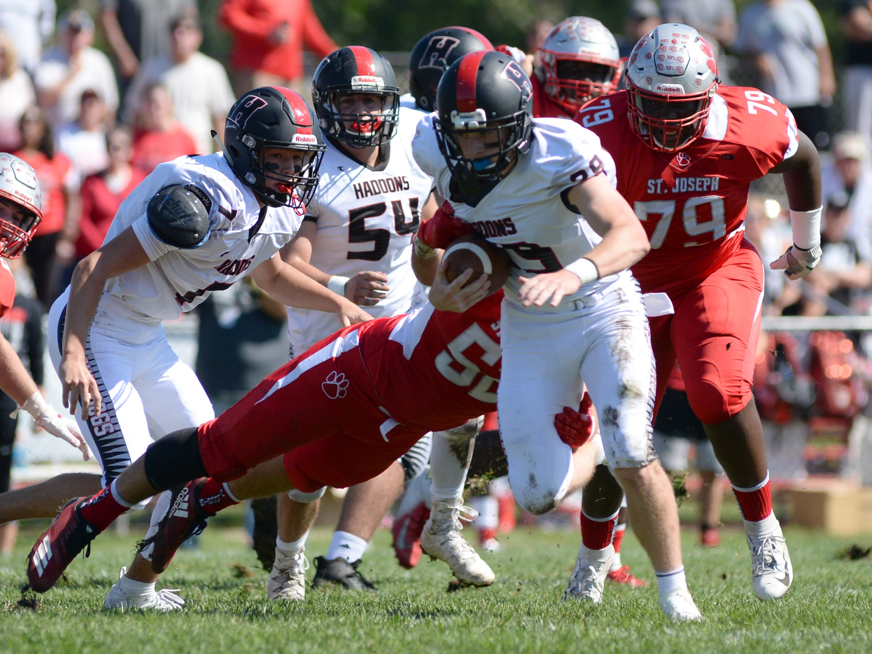 Haddonfield's Tommy Batson runs the ball during Saturday's game against St. Joseph, Sept. 29, 2018.