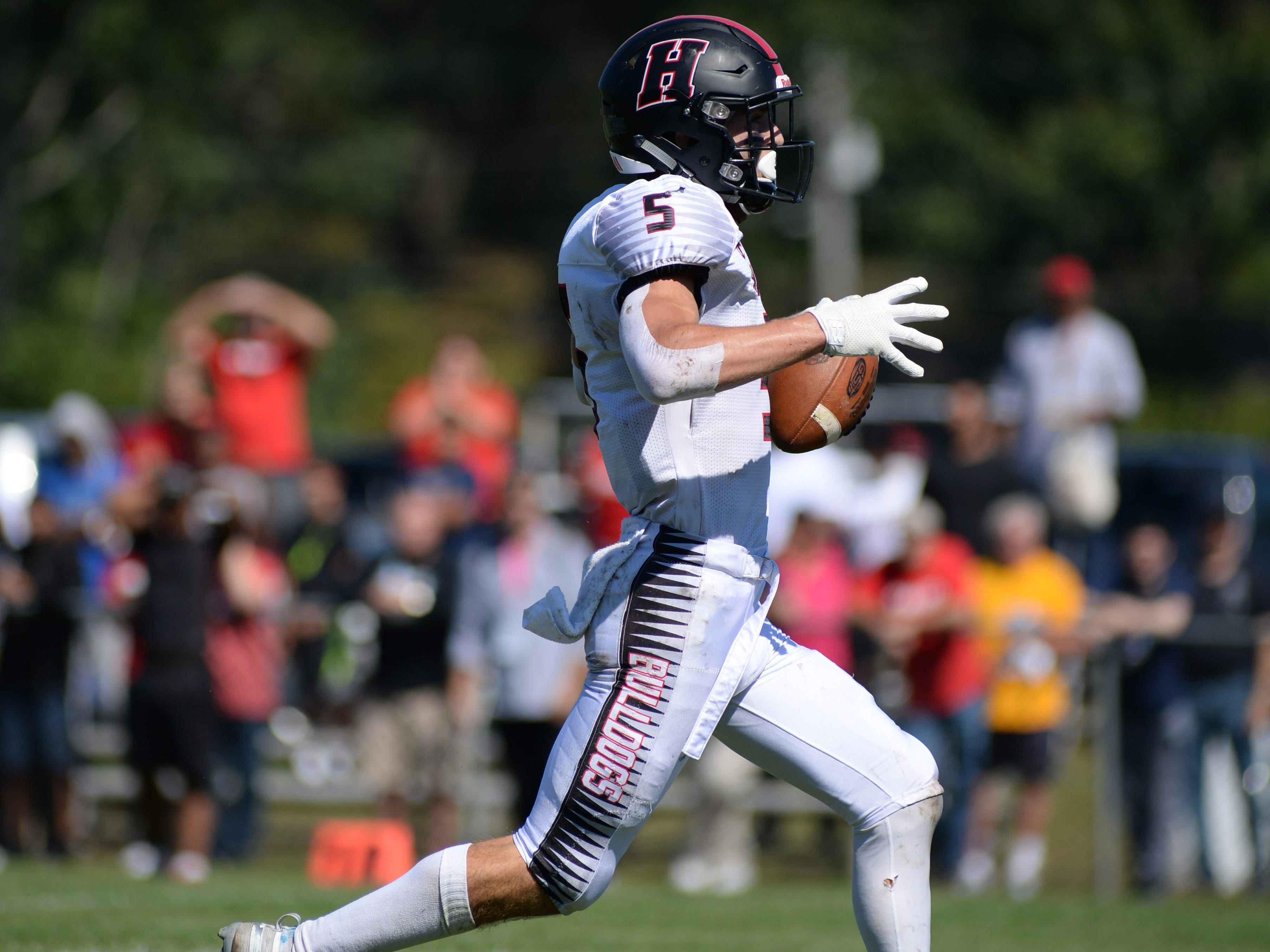 Haddonfield's Johnny Foley (5) runs for a touchdown during the first half of Saturday's game against St. Joseph, Sept. 29, 2018.