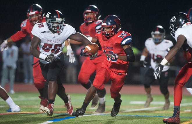 Willingboro's Zaire Clements runs the ball during Friday's football game between Willingboro and Cinnaminson, played at Moorestown High School on Friday night.
