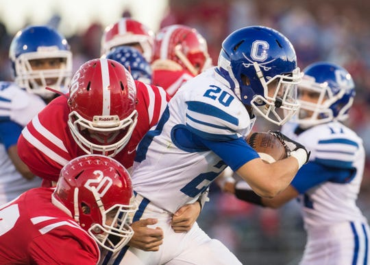 Chillicothe's McKellan Lee, 20, pushes through a tackle as the Cavaliers take on the  Hillsboro Indians at Richards Memorial Field on Friday, Sept. 28, 2018. The Cavaliers defeated the Indians 36-30.