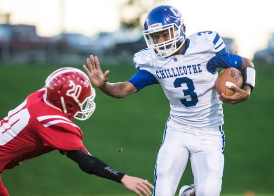 Chillicothe's wide receiver J'Quan Harris, 3, dodges a tackle as the Cavaliers take on the  Hillsboro Indians at Richards Memorial Field on Friday, Sept. 28, 2018. The Cavaliers defeated the Indians 36-30.