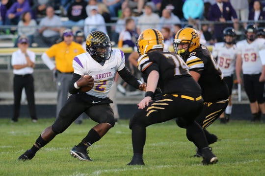 Unioto's Jamarcus Carroll runs the ball during a game against Paint Valley during the 2018 season at Paint Valley High School.