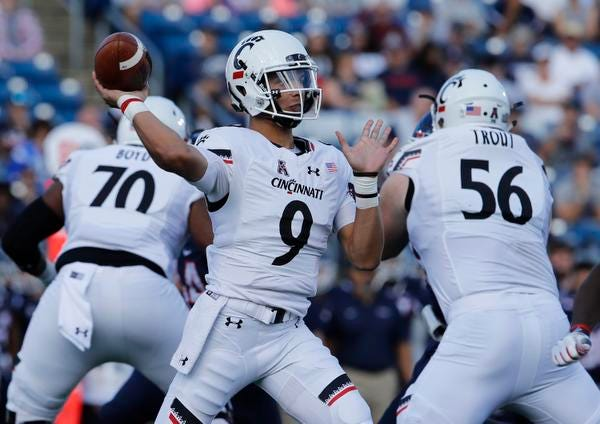 Sep 29, 2018; East Hartford, CT, USA; Cincinnati Bearcats quarterback Desmond Ridder (9) throws a pass against the Connecticut Huskies in the first quarter at Pratt & Whitney Stadium at Rentschler Field. Mandatory Credit: David Butler II-USA TODAY Sports