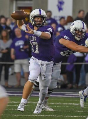 Elder quarterback Michael Bittner throws a pass against St. X, Elder High School, Friday, Sept. 28, 2018