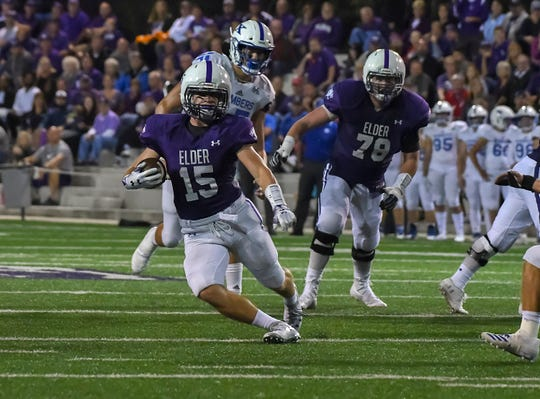 Luke Masminster runs through the St. X defense, Elder High School, Friday, Sept. 28, 2018