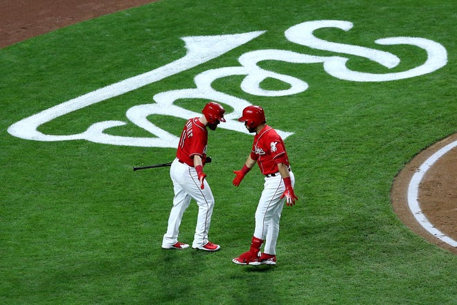 Reds third baseman Eugenio Suarez is congratulated by catcher Tucker Barnhart after hitting a two-run home run in the third inning.