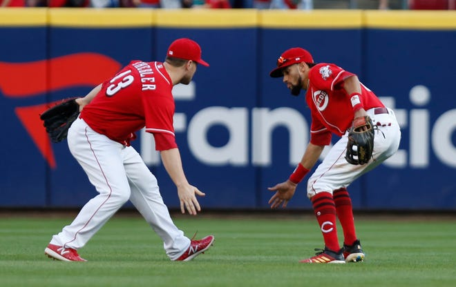 Sep 29, 2018; Cincinnati, OH, USA; Cincinnati Reds left fielder Scott Schebler (43) and center fielder Billy Hamilton (6) react after the Reds defeated the Pittsburgh Pirates at Great American Ball Park. Mandatory Credit: David Kohl-USA TODAY Sports