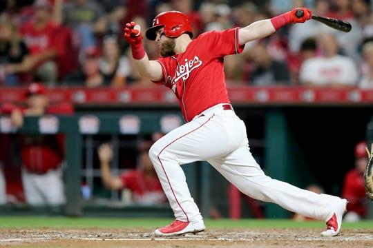 Reds catcher Tucker Barnhart singles in the fifth inning.