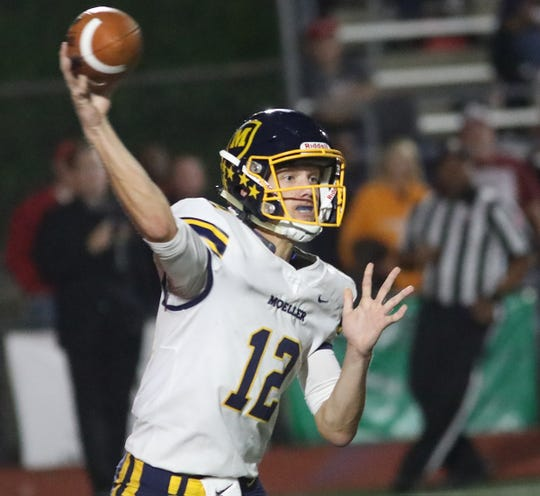Moeller quarterback Mitch McKenzie throws a pass during their football game against La Salle. Friday, Sept 28, 2018.