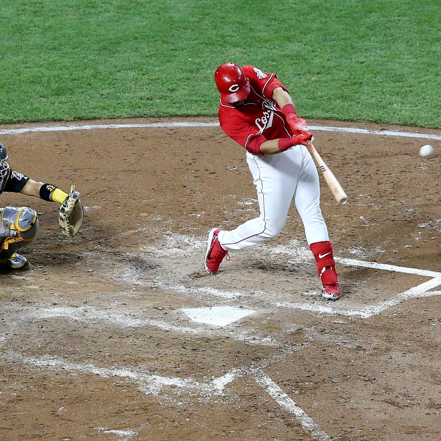 Reds third baseman Eugenio Suarez hits a two-run...