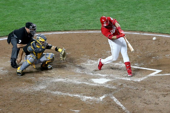 Reds third baseman Eugenio Suarez hits a two-run home run in the third inning.