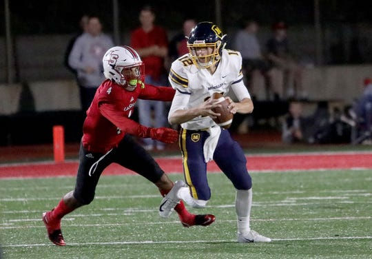 Moeller's quarterback Mitch McKenzie is sacked by La Salle's Iesa Jarmon during their football game, Friday, Sept 28, 2018.