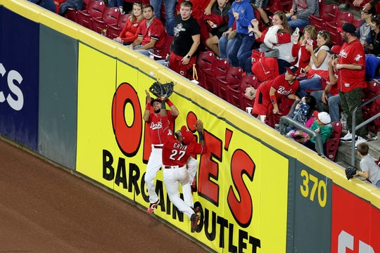 Reds center fielder Billy Hamilton makes a catch at the wall in the fourth inning.