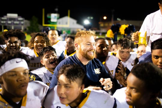 Northeast head coach Chad Watson smiles with his team after the game at Clarksville High on Sept. 28, 2018, in Clarksville.